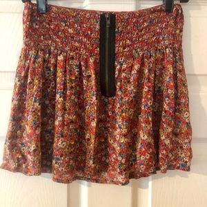 Smocked red floral mini skirt w/ zipper in front